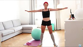 Sporty redhead Tiffany Love keeps working on her wet pussy a bit