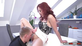 Steamy Redhead Gives A Sucking Cock In The Office